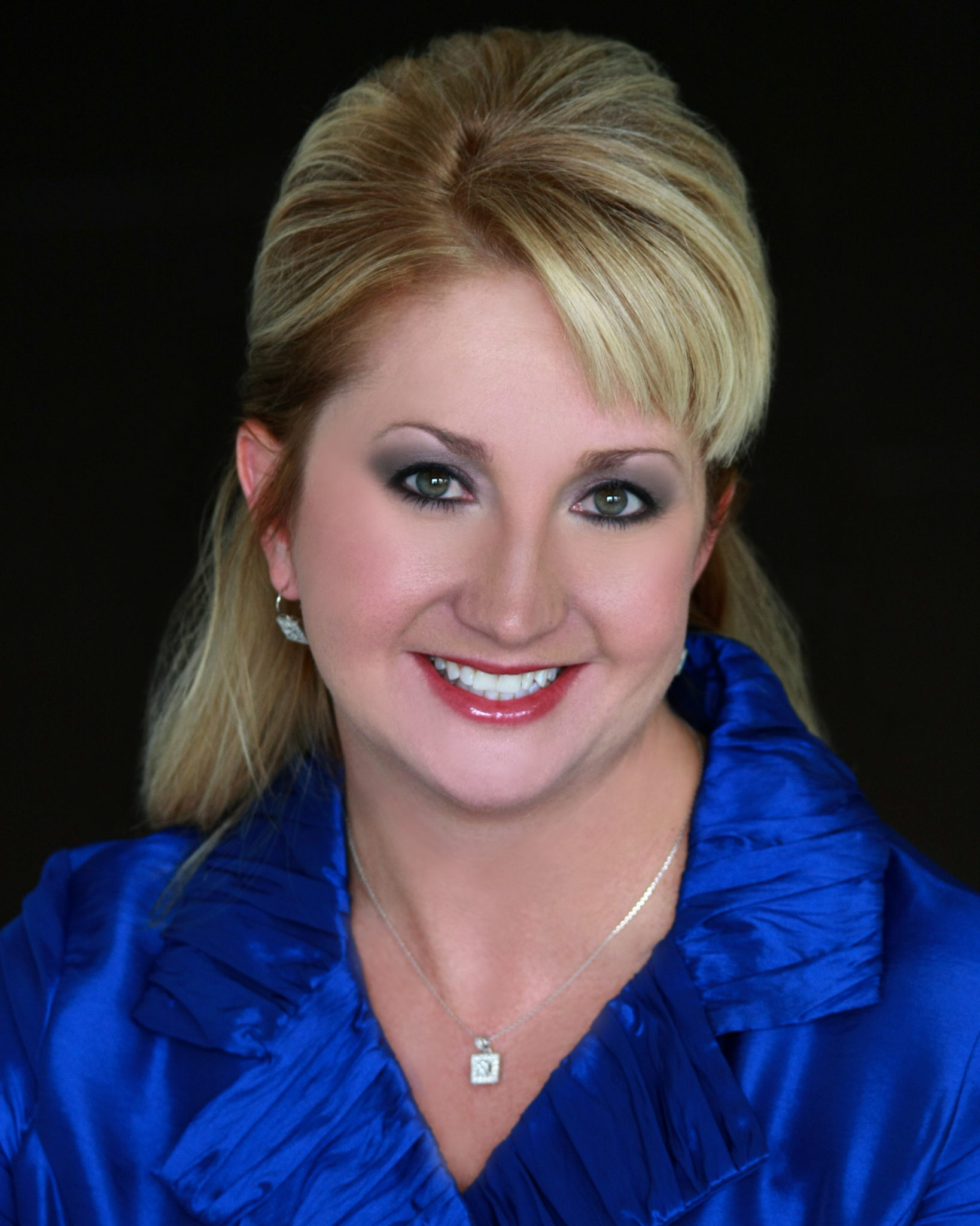 A photo of Lisa Tolliver, the owner of Posh Productions, the best wedding planner in Johnson City